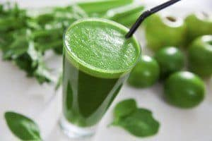 Healthy green celery, apple and lime juice